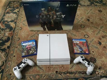 White PS4 with 2 games and extra controller