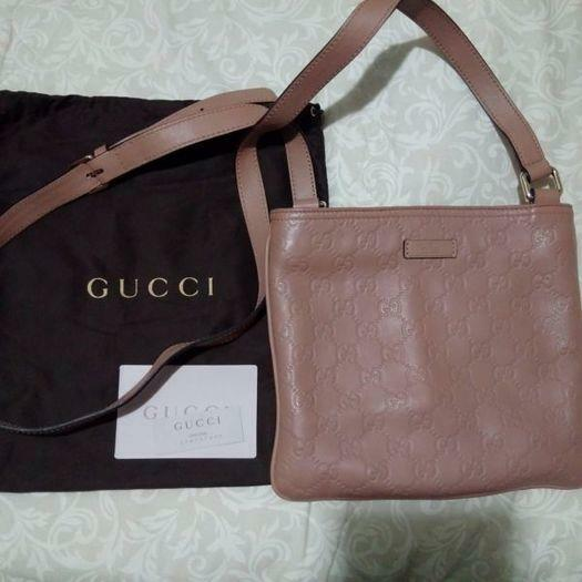 Authentic Gucci Leather slingbag in EXCELLENT condition at S$350